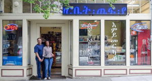 Mr. & Mrs. Filli & Yodit Abdulkdra in front of 'Amy's Merkato' store © 2013, photo by Madeline Crowley